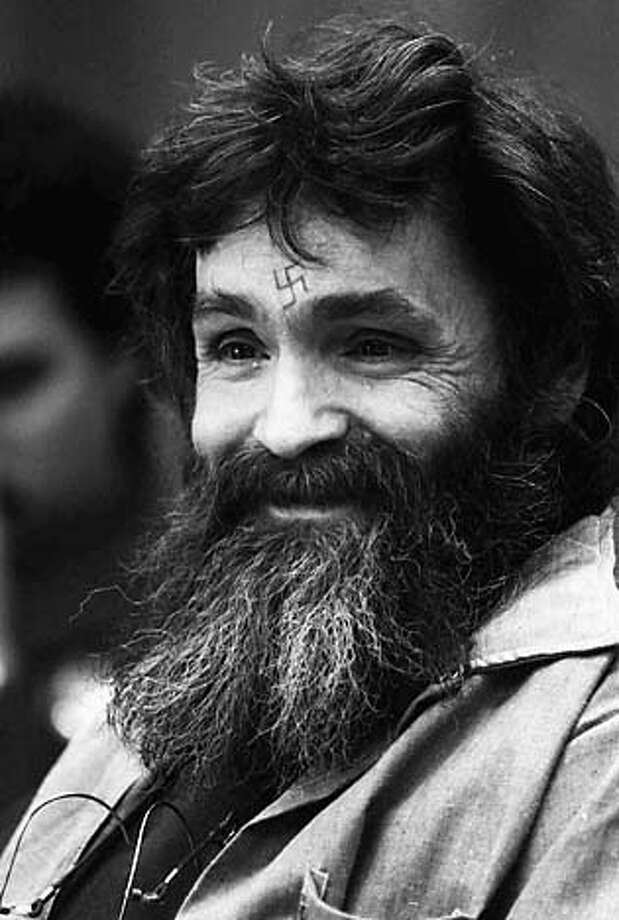 FILE-- Charles Manson is shown in this 1986 file photo. Mass murderer Charles Manson has been moved to California's toughest prison after authorities said they caught him dealing drugs. Manson, who was convicted in 1971 of seven murders, including that of actress Sharon Tate, was transported Tuesday from Corcoran State Prison to Pelican Bay State Prison. (AP Photo/Eric Risberg) CAT Photo: ERIC RISBERG