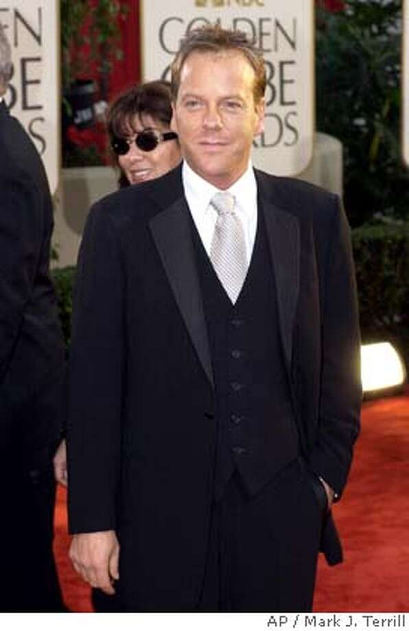 "Kiefer Sutherland, nominated for best performance by an actor in a television series/drama for his work in ""24,"" arrives for the 60th Annual Golden Globe Awards, in Beverly Hills, Calif., Sunday, Jan. 19, 2003. (AP Photo/Mark J. Terrill) Photo: MARK J. TERRILL"