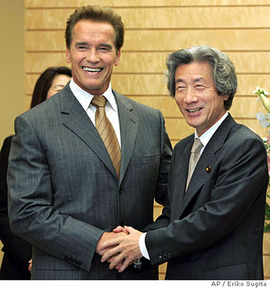 California Governor Arnold Schwarzenegger, left, beams as he meets with Japanese Prime Minister Junichiro Koizumi at the premier's official residence in Tokyo Friday, Nov. 12, 2004. Schwarzenegger met Koizumi and other top Japanese officials during a California trade and tourism blitz in Tokyo, as the governor tries to fill his state's drained coffers by luring business from the world's second-biggest economy.(AP Photo/Eriko Sugita, POOL) Photo: ERIKO SUGITA