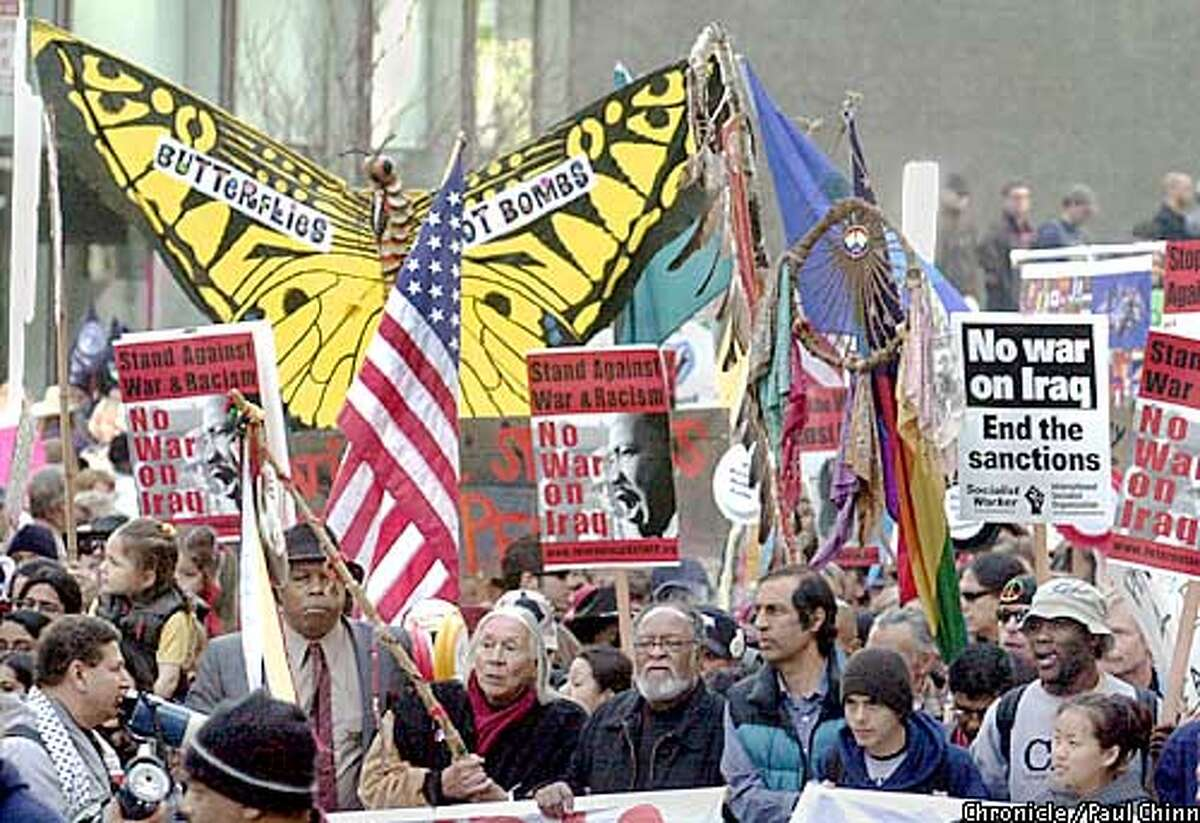 Peace activists brought a huge butterfly to the front of the march. Thousands of protestors marched down Market St. to demonstrate against a possible war against Iraq. PAUL CHINN/SF CHRONICLE