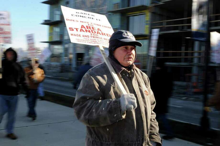 Stanley Szydlowski, a member of the Local 210 chapter of the New England Carpenters Union protest outside a high-rise apartment under construction as part of the Harbor Point redevelopment. Photo: Lindsay Niegelberg / Stamford Advocate