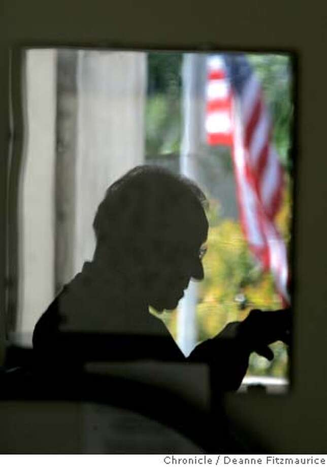 VEday_384_df.JPG  Arthur Roth is reflected in a picture frame with a flag outside his window as he recalls days in the war. He recalls V-E Day and his days in Germany during the war. He is in his home study in San Francisco. Deanne Fitzmaurice/The Chronicle Photo: Deanne Fitzmaurice