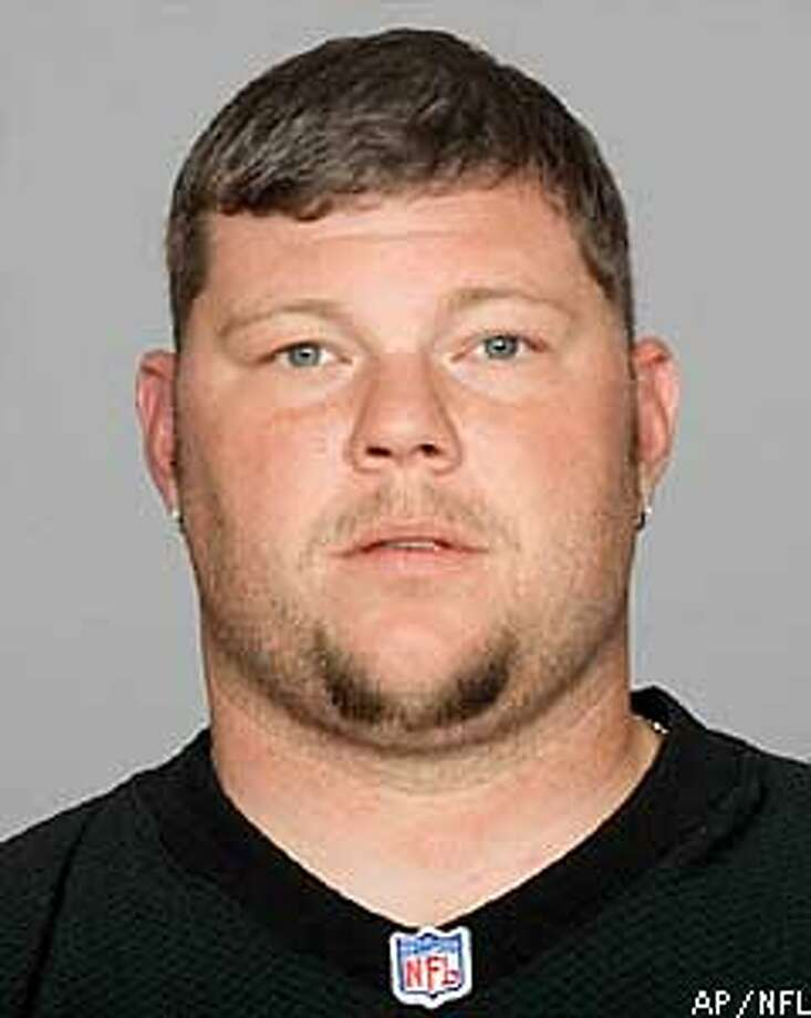 ** FILE ** Oakland Raiders All-Pro center Barret Robbins appears in this 2002 file photo. The agent for Barret Robbins confirmed Monday, Feb. 3, 2003, that the All-Pro center has bipolar disorder, and that he expressed ``remorse and deep sadness'' for missing the Super Bowl. Robbins remains hospitalized because of his condition, agent Drew Pittman said in a statement to ESPN. (AP Photo/NFL,file)