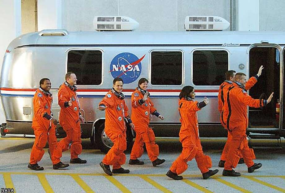"The Columbia crew, including Israel's first astronaut Ilan Ramon (3rdL), heads for the Astrovan and a ride to Launch Pad 39A for liftoff at Cape Canaveral, Florida, January 16, 2003. From left, are: Payload Commander Michael Anderson, Mission Specialist David Brown, Payload Specialist Ramon, Mission Specialists Laurel Clark and Kalpana Chawla, Mission Commander Rick Husband and Pilot William ""Willie"" McCool. Ramon, hailed as the John Glenn of his nation, is the first astronaut from Israel to fly on a Shuttle. The 16-day mission is devoted to research and will include more than 80 experiments that will study Earth and space science, advanced technology development, and astronaut health and safety. REUTERS/Scott Andrews/NASA/Handout/ FOR EDITORIAL USE ONLY Photo: NASA"