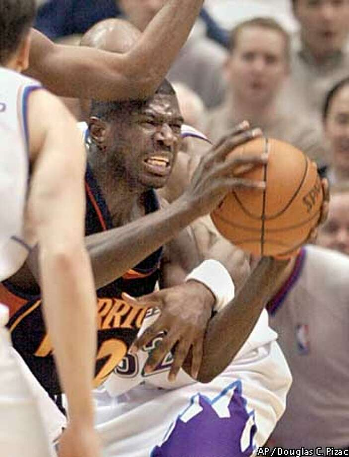 Golden State Warriors guard Jason Richardson looks for someone to pass to as he is surrounded by Utah Jazz players during the fourth quarter Friday, Jan. 31, 2003, in Salt Lake City. The Jazz beat the Warriors, 102-94. (AP Photo/Douglas C. Pizac) Photo: DOUGLAS C. PIZAC
