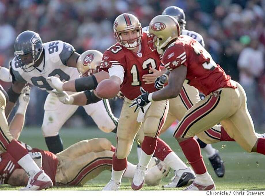49ers268_cs.jpg  Event on 11/7/04 in San Francisco  San Francisco 49ers Tim Rattay (13) hands off in the third quarter to Kevan Barlow in their 27-42 lossto the Seattle Seahawks at Monster Park. Chris Stewart / The Chronicle MANDATORY CREDIT FOR PHOTOG AND SF CHRONICLE/ -MAGS OUT Sports#Sports#Chronicle#11/10/2004#ALL#5star##0422456014 Photo: Chris Stewart