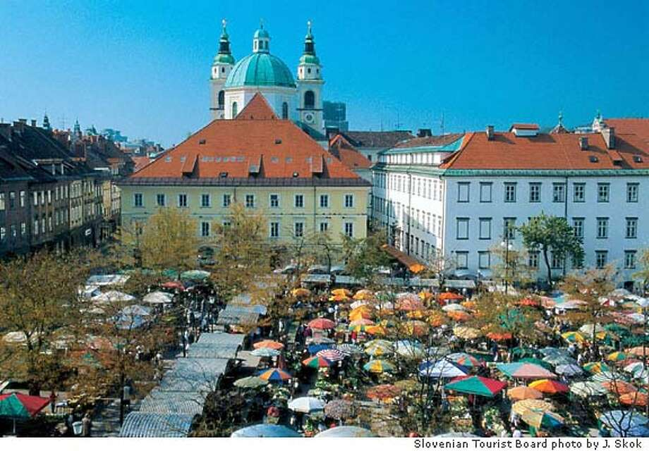 The open market in Ljubljana is more than just shopping, it's also about the architecture in Slovenia's capital. Illustrates TRAVEL-EUROPE (category t), by Gary Lee and Andrea Sachs (c) 2004, The Washington Post. Moved Monday, April 26, 2004. (MUST CREDIT: Slovenian Tourist Board photo by J. Skok.) Travel#Travel#Chronicle#11/07/2004#ALL#Advance##0421737558 Photo: J. SKOK