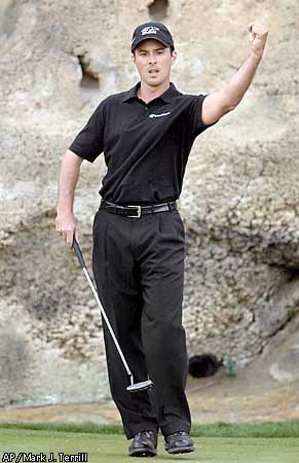 Mike Weir of Canada reacts after sinking a birdie putt on the 17th hole at the Palmer course at PGA West during the final round of the Bob Hope Chrysler Classic, Sunday, Feb. 2, 2003, in La Quinta, Calif. Weir won the tounament with a 30-under-par to beat Jay Haas by two strokes. (AP Photo/Mark J. Terrill) Photo: MARK J. TERRILL