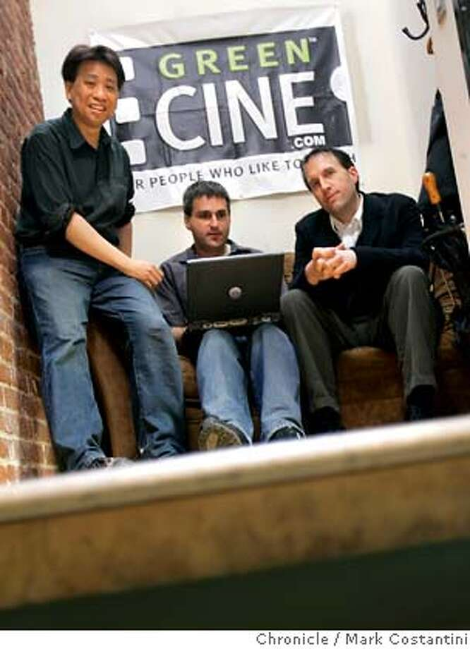 "bizblogs_074_mc.jpg GreenCine (pronounced ""green scene"") is an SF firm that provides online rental of DVDs, with a focus on avant-garde and international type films. As part of their marketing efforts, they produce a blog in which their staff provides daily commentaries on developments in the film world. This story is about small businesses that are experimenting with the use of blogs in marketing themselves. It will look at whether blogs can be truly useful to small businesses like GreenCine, or whether this is just the latest overhyped Internet gimmick of the month. GreenCine is doing more with blogging than almost any other small business, kind of a model of the potential. They credit their blog with helping increase traffic to their main web site from about 50,000 hits a month to a million hits per month.  Craig Phillips(middle) is one of two staffpeople who edit the blog. (The other staffperson is unfortunately based in Berlin.) The founder of the company is Dennis Woo(left). Also picuterd is Jonathan Marlow, Business Development/Content Acquisitions Director who is involved with the blog.  City:� Photo taken on 5/4/05, in San Francisco, CA. Photo: Mark Costantini"