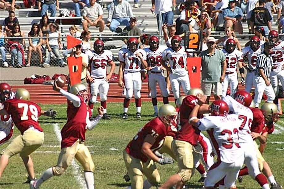 WRIGHT10.JPG Kyle Wright, the Cardinal Newman High School quarterback (with the ball at the center of photo). HANDOUT Sports#Sports#Chronicle#11/10/2004#ALL#5star##0422457203