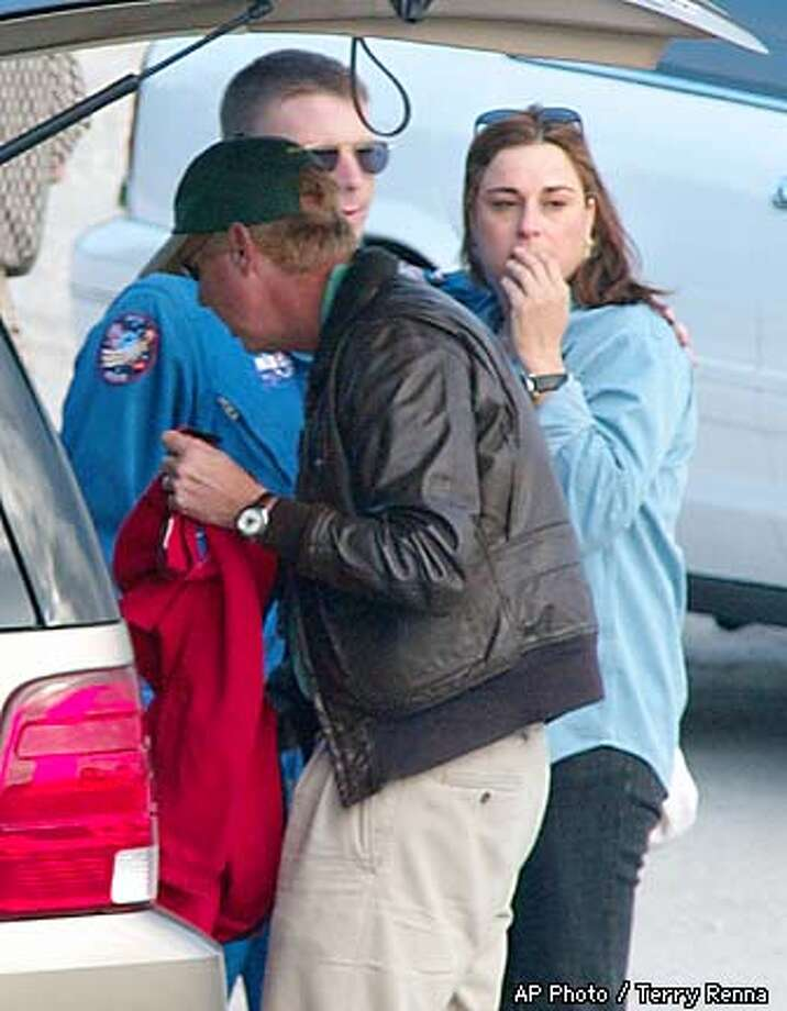 Rona Ramon, right, wife of Columbia astronaut Ilan Ramon is consoled as she leaves the landing facility after Columbia broke up over Texas on Saturday, Feb. 1, 2003 at the Kennedy Space Center in Cape Canaveral, Fla. (  AP Photo / Terry Renna Photo: TERRY RENNA