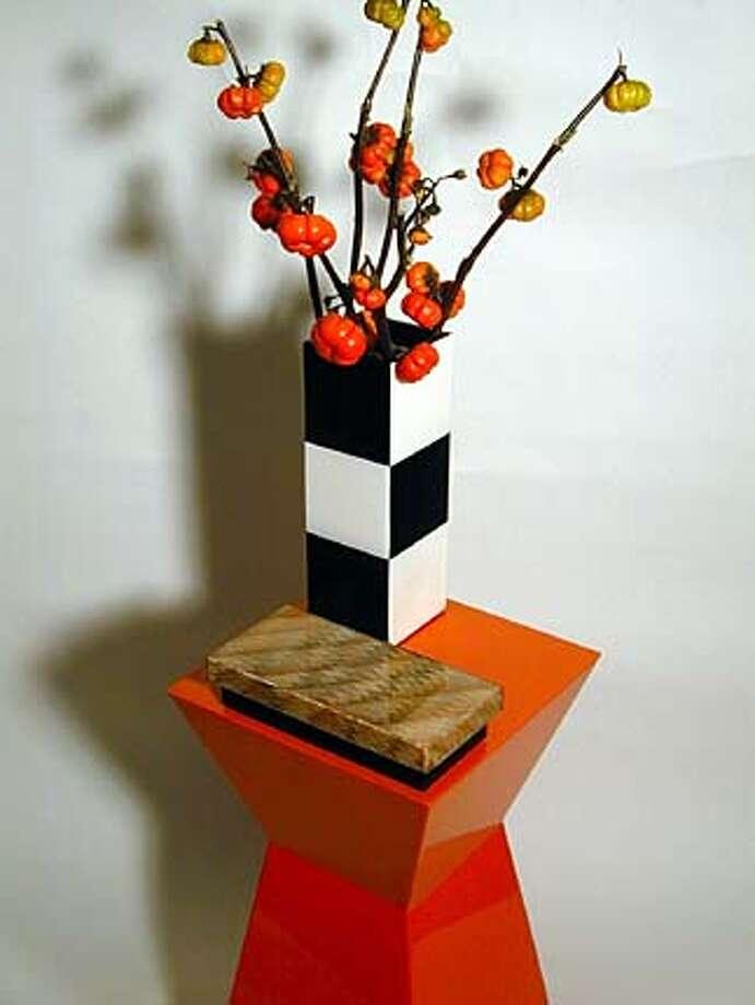 Pedestal/Vase Photo: Orange Lacquered Pedestal, Sale Priced at $125.00, Retail $500.00., Vase, Black/White, $15.00, Retail $50.00