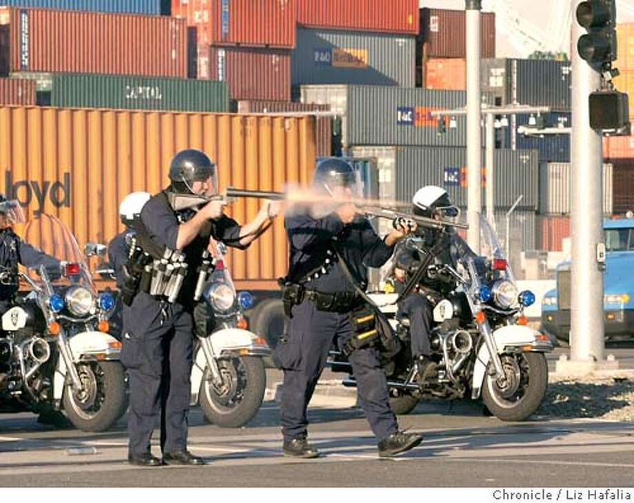 About 200 protesters blocked the entrances to three businesses at the Port of Oakland this morning. Oakland police arrived with bean bag rounds, sting balls, wooden dowels. (PHOTOGRAPHED BY LIZ HAFALIA/THE SAN FRANCISCO CHRONICLE) Photo: LIZ HAFALIA