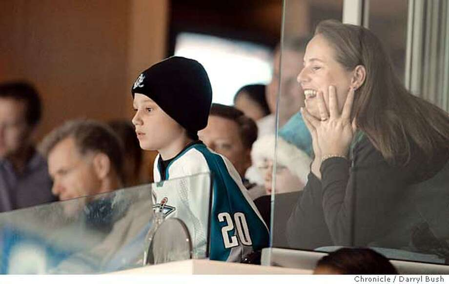 Megan Swyt (right) and son Zachary take in the only hockey action at HP Pavilion this season. Chronicle photo by Darryl Bush