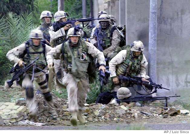 November 9, 2004--Fallouja, Iraq--Marines return fire down a street at an insurgent hideout in the city of Fallujah, Iraq. MANDATORY CREDIT: Luis Sinco/Los Angeles Times MANDATORY CREDIT*** , , NO FOREIGN, NO MAGS, LOS ANGELES DAILY NEWS OUT, OC REGISTER OUT, VENTURA COUNTY STAR OUT, INLAND VALLEY DAILY BULLETIN OUT, SAN BERNARDINO SUN OUT Photo: Luis Sinco