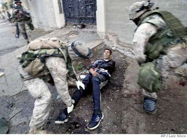 November 9, 2004--Fallouja, Iraq--U.S. Marines tend to a wounded insurgent in the city of Fallujah, Iraq. MANDATORY CREDIT: Luis Sinco/Los Angeles Times MANDATORY CREDIT*** , , NO FOREIGN, NO MAGS, LOS ANGELES DAILY NEWS OUT, OC REGISTER OUT, VENTURA COUNTY STAR OUT, INLAND VALLEY DAILY BULLETIN OUT, SAN BERNARDINO SUN OUT Photo: Luis Sinco