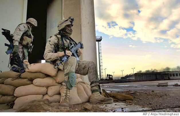 US Marines guard the railroad station in Fallujah, Iraq, early morning, Tuesday, Nov. 9, 2004. U.S. Army and Marine units entered the insurgent stronghold of Fallujah through a breach near the railroad station at dawn Tuesday. (AP Photo/Anja Niedringhaus) Photo: ANJA NIEDRINGHAUS