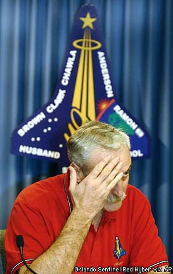 NASA Administrator Sean O'Keefe rubs his forehead prior to a news conference at Florida's Kennedy Space Center, Saturday, Feb. 1, 2003. NASA lost communication with the Columbia Saturday after it broke apart in flames over Texas, killing all seven astronauts just minutes before they were to glide to a landing in Florida.(AP Photo/Orlando Sentinel Red Huber) Photo: RED HUBER