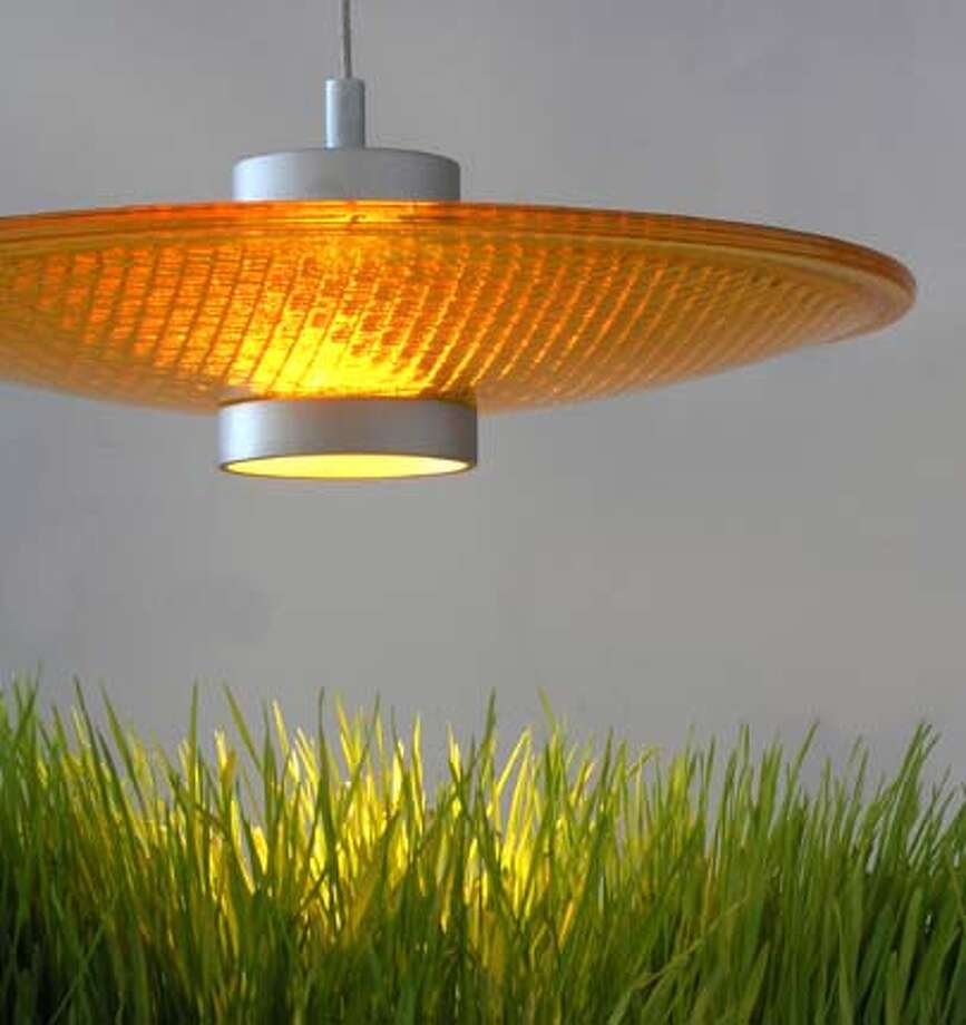 Daniel Krivens� �Stoplight Pendant� is made of LED lights and recycled traffic light lenses.