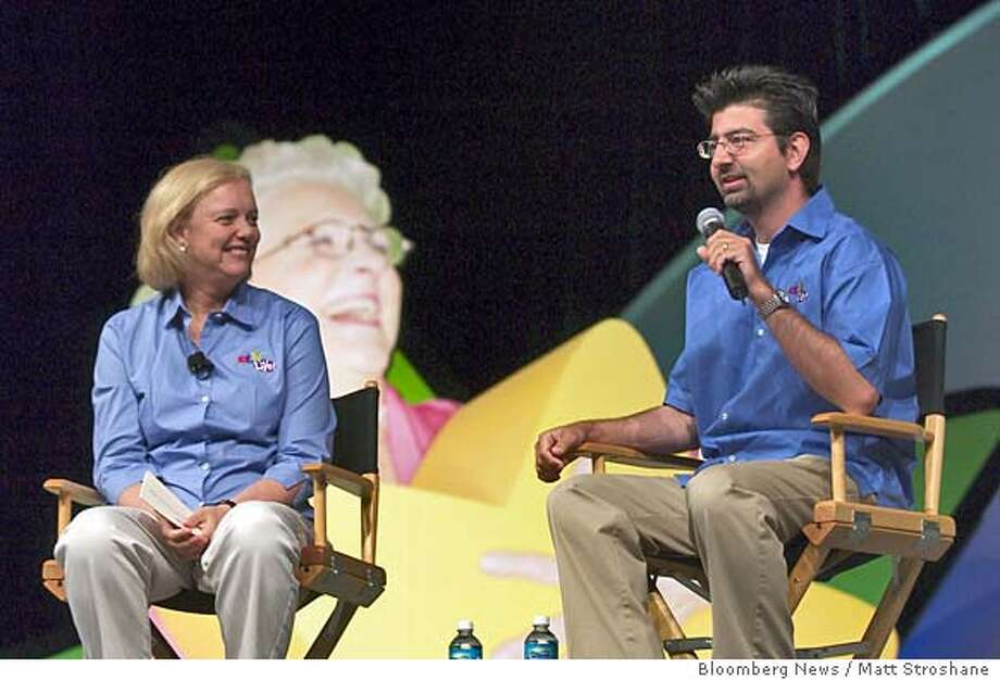 Meg Whitman, president and CEO of eBay, left, looks on as Pierre Omidyar, founder and chairman of eBay, speaks at the 2nd annual eBay Live! Community Conference in Orlando, Florida on June 27, 2003. EBay has been one of the most successful survivors of the dot-com boom and bust by focusing on boosting sales, getting rid of unprofitable operations such as Butterfields, a fine-art auctioneer, and buying its biggest rival in payment processing. Photographer: Matt Stroshane / Bloomber News. Photo: Matt Stroshane