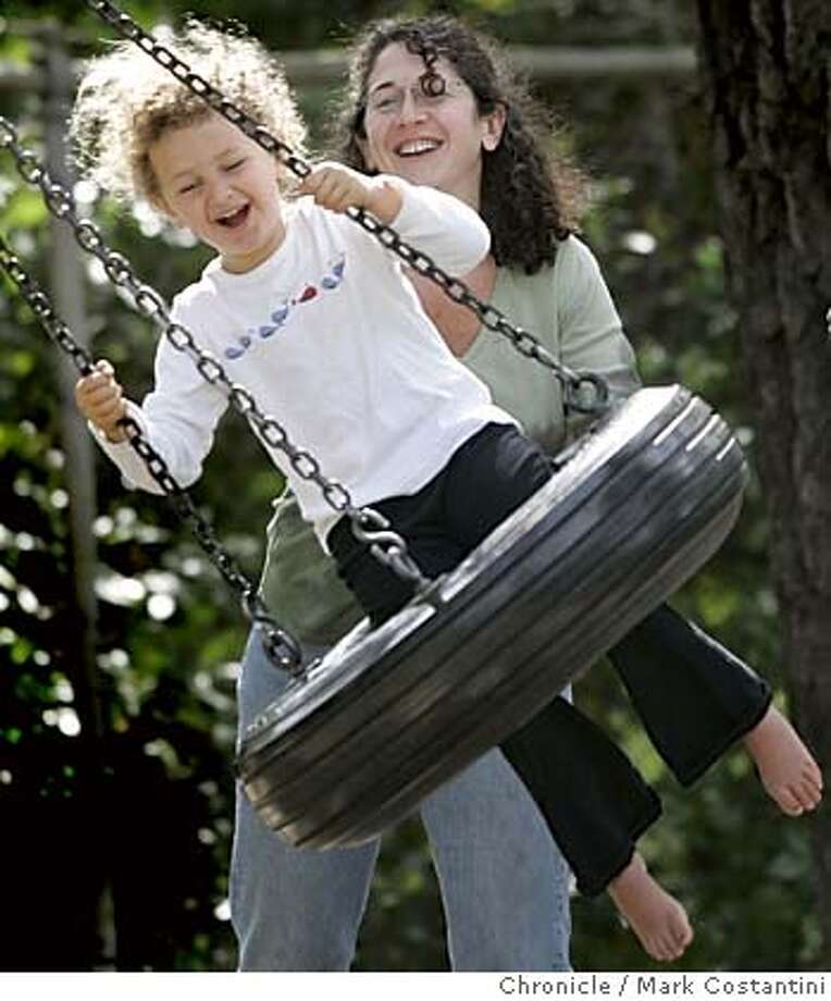 weather_150_mc.jpg  Bella Kocabiyik, 5, Oakland, smiles as she gets a push from her mom, LizKocabiyik on the tire swing at Orinda Community Park. Mark Costantini/San Francisco Chronicle MANDATORY CREDIT FOR PHOTOG AND SF CHRONICLE/ -MAGS OUT Photo: Mark Costantini