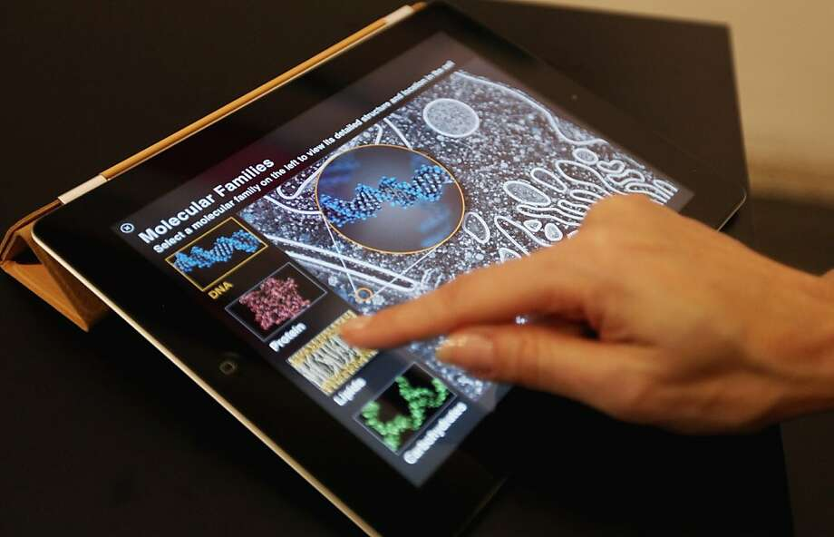 The iBooks 2 app is demonstrated on at iPad at an event for the media at the Guggenheim Museum in New York. Photo: Mario Tama, Getty Images