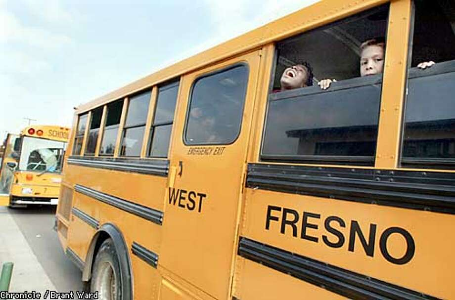 As school comes to an end at West Fresno Elementary, two boys wait for their bus to take them home. A rogue school board has misused millions of dollars in funds but the kids have still managed to raise their test scores. By Brant Ward/Chronicle Photo: BRANT WARD
