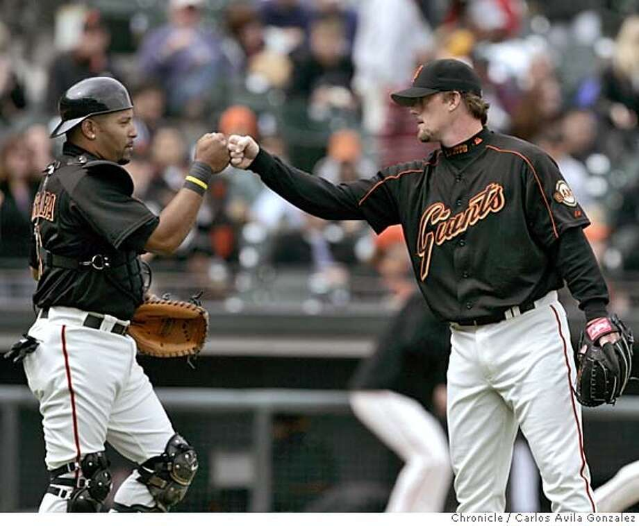 GIANTS04_007_CAG.JPG  Giants' catcher, Yorvit Torrealba, left, and pitcher, Jim Brower, high five at the end of the game after the Giants defeated the Texas Rangers. The San Francisco Giants played the Texas Rangers at SBC Park in San Francisco, Ca., on Sunday, April 3, 2005. The Giants won 7-4.  Photo by Carlos Avila Gonzalez / The San Francisco Chronicle  Photo taken on 4/3/05 in San Francisco, CA. MANDATORY CREDIT FOR PHOTOG AND SAN FRANCISCO CHRONICLE/ -MAGS OUT Photo: Carlos Avila Gonzalez