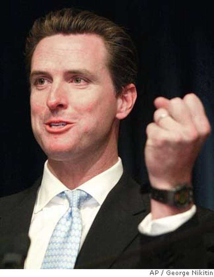 San Francisco Mayor Gavin Newsom speaks at a news conference, Wednesday Nov. 3, 2004, in San Francisco. Mayor Newsom reacted strongly to the suggestion that he was personally to blame for President Bush's victory because he had pushed the issue onto the national stage. (AP Photo/George Nikitin)