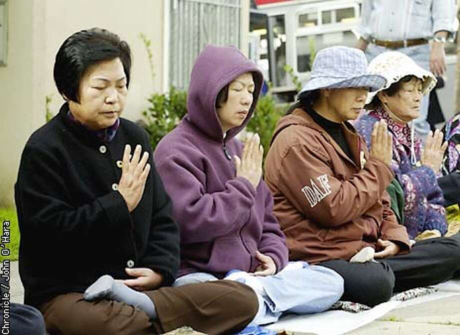 CHINESE CONSULATE, 1450 LAGUNA ST. SAN FRANCISCO,CA  a deminstration across from the Chinese Consulate for the release of Charles Li. Four women, (l to R)  Mao. Fuzhen, Tan. Shuizhu, Sun. Chanhua & Li. Suzheng in prayer adn medatition durning protest.  Photo/john O'hara