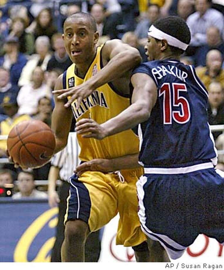 California's Ayinde Ubaka drives past Arizona's Mustafa Shakur during the second half Thursday, Feb. 5, 2004, in Berkeley, Calif. Ubaka had nine points in California's 87-83 win over No. 12 Arizona. (AP Photo/Susan Ragan) Cal's Ayinde Ubaka (driving on Arizona's Mustafa Shakur) has been playing relaxed basketball since the Jan. 10 win over ASU. ProductName	Chronicle Cal's Ayinde Ubaka (driving on Arizona's Mustafa Shakur) has been playing relaxed basketball since the Jan. 10 win over ASU. ProductName	Chronicle Sports#Sports#Chronicle#11/9/2004#ALL#5star##0421606083 Photo: SUSAN RAGAN
