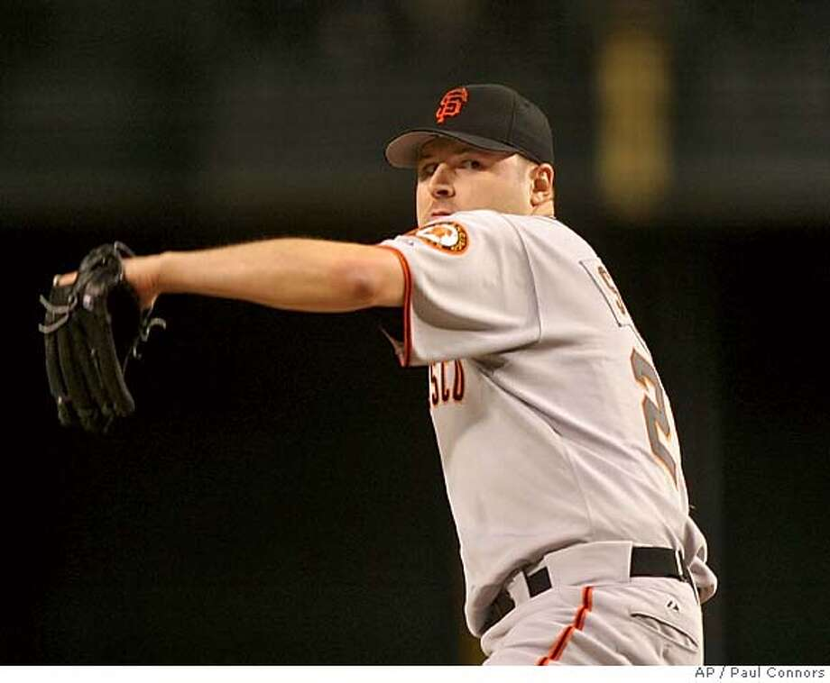 San Francisco Giants pitcher Jason Schmidt delivers a pitch against Arizona Diamondbacks batter Royce Clayton in the second inning Monday, May 2, 2005, at Bank One Ballpark in Phoenix.(AP Photo/Paul Connors) Photo: PAUL CONNORS