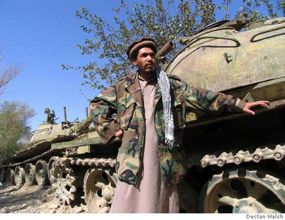 Commander Mafouz, an Afghan militia officer who refuses to surrender two Soviet tanks parked outside his house in Kareza, a village in Kapisa province, north of Kabul. October 2004, By Declan Walsh Photo: Declan Walsh