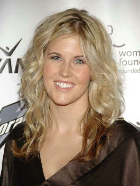 FILe - In this Oct. 15, 2007, file photo, honoree Sarah Burke arrives at the Women's Sports Foundation's 28th Annual Salute to Women in Sports at the Waldorf-Astoria Hotel in New York. Burke died Thursday, Jan. 19, 2012, nine days after crashing at the bottom of the superpipe during a training run in Utah. She was 29. Burke was injured Jan. 11 while training at a personal sponsor event at the Park City Mountain resort. Photo: AP