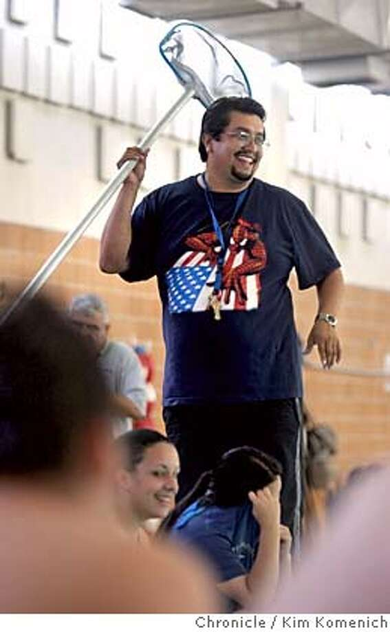 "DREAM_048_kk.jpg  O'Connell High Athletic Director Bob Gamino teaches a swimming class Garfield Pool at 26th and Harrison. Gamino is among SF teachers who must reapply for their jobs because their school is being named one of the school district's ""dream schools.""  Photo by Kim Komenich in San Francisco Metro#Metro#Chronicle#11/9/2004#ALL#5star##0422427685 Photo: Kim Komenich"