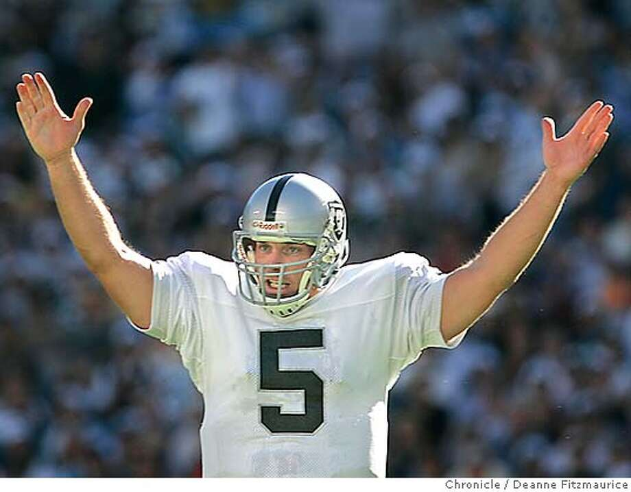 Kerry Collins, Raiders quarterback and former Panther, raises his arms in the air as the Raiders score a second touchdown in the 2nd quarter for a 16-7 lead. The Oakland Raiders win over the Carolina Panthers at Bank of America Stadium in Charlotte, North Carolina.  Deanne Fitzmaurice / The Chronicle Photo: Deanne Fitzmaurice