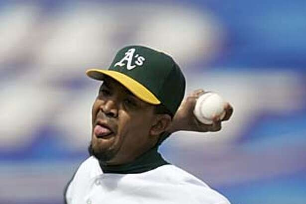 Octavio Dotel got the save after coming in in the ninth inning. The Athletics played the Seattle Mariners at McAfee Coliseum on Sunday, May 1, 1005. Swisher crashed into the wall and injured his right shoulder on the play, and was taken out of the game and to the hospital for X-Rays. There was no word on the extent of his injuries. Photo taken on 05/01/05, in Oakland, Ca. Photo by Carlos Avila Gonzalez/The San Francisco Chronicle