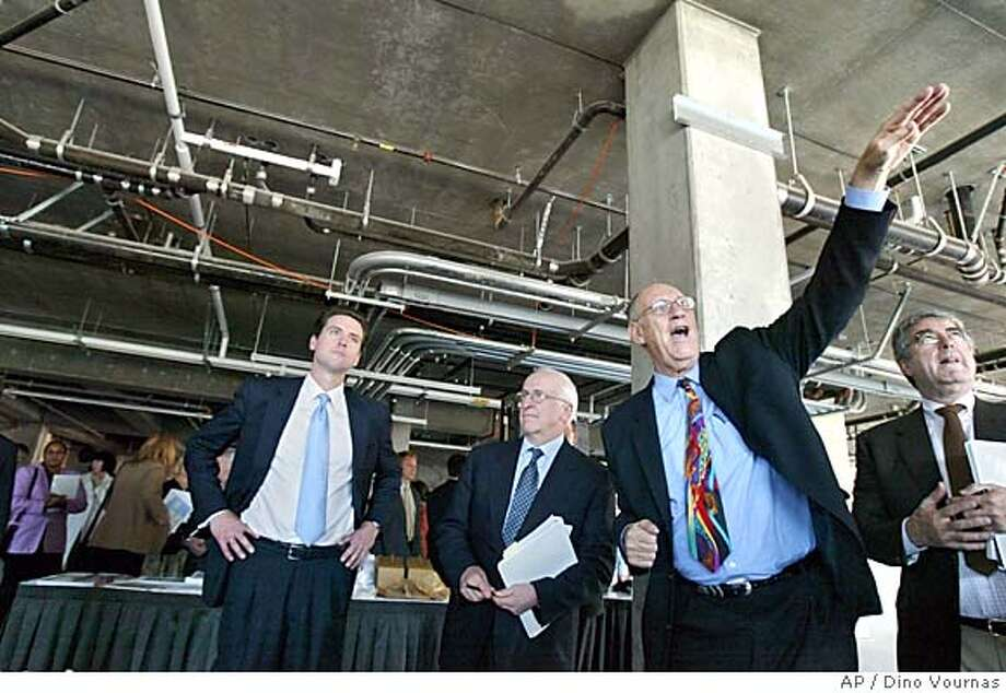 Project architect Arthur Gensler, second right, describes the amenities of the proposed King Street headquarters of the California Institute for Regenerative Medicine with San Francisco mayor Gavin Newsome, left, and committee member Dr. Richard Murphy, center, on Friday, April 29, 2005, in San Francisco. An influential panel of the state's newly created stem cell agency endorsed San Francisco on Monday, May 2, 2005, as its top pick to host the agency overseeing California's $3 billion public investment in stem cell research. (AP Photo/Dino Vournas) Photo: DINO VOURNAS