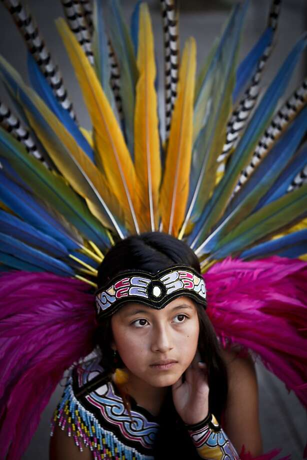 Eleven year old Xochiquetzalli Pena, seen on Tuesday, Jan. 10, 2012 in San Francisco, Calif., started dancing La Danza Azteca at age 3. Photo: Russell Yip, The Chronicle