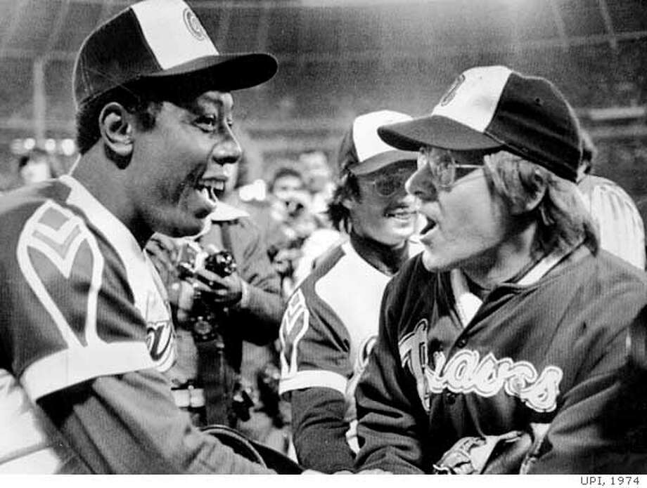 Tom House, right, with Hank Aaron after house rerrieved Aaron's 715th home run ball, Apirl 7, 1974.  UPI Photo Ran on: 05-03-2005  Tom House, who caught Hank Aaron's 715th home run ball, tried &quo;everything'' to improve his speed.