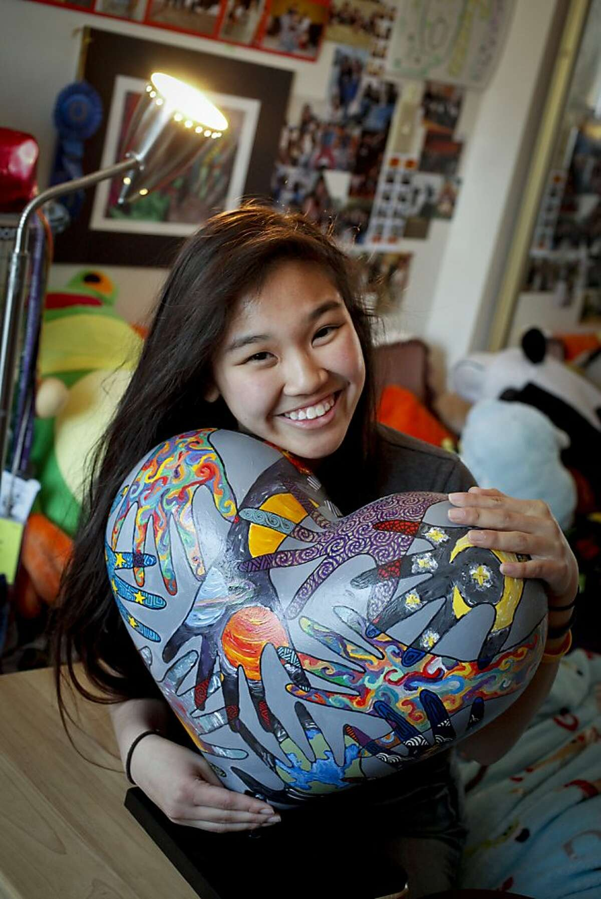 Lori Chinn, a 15-year old Lowell High School sophomore, is seen with her Heroes & Hearts submission,