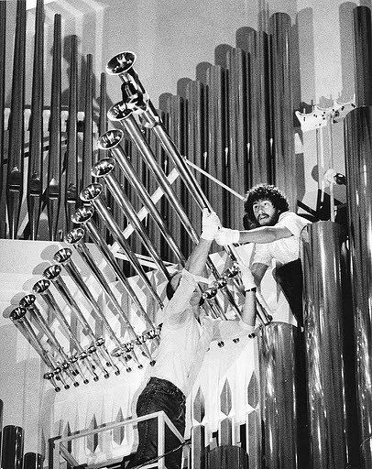 Two installers adjust the last pipes to be installed in the Ruffatti pipe organ in Davies Symphony Hall (1984). Photo credit: Chris Stewart