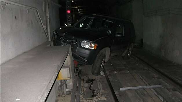 Police say 40-year-old Scott Mitchell of Sebastopol drove his SUV into a Muni tunnel, snarling the morning commute. Mitchell was arrested on suspicion of driving under the influence, failure to obey a stop sign and driving on train tracks on Thursday, Jan. 19, 2012. Photo: Sfmta, Courtesy