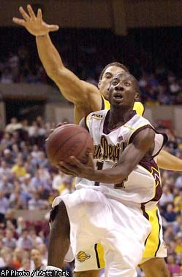 Arizona State guard Curtis Millage (14) scores past California's Joe Shipp during the first half Thursday, Jan. 30, 2003 at Wells Fargo Arena in Tempe, Ariz.(AP Photo/Matt York) Photo: MATT YORK