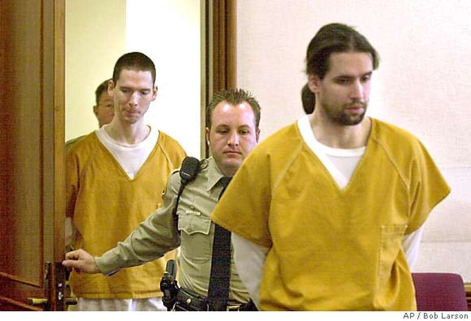 Brothers Justin Helzer, 29, left, and Glenn Helzer, 31, are led into court for a preliminary hearing in Martinez, Cailf., Monday Dec. 3, 2001. The Helzers and their housemate Dawn Godman, 27, are accused of going on a killing spree that left five people dead including Selina Bishop, the daughter of blues guitarist Elvin Bishop. (AP Photo/Contra Costa Times, Bob Larson ) Ran on: 06-10-2004  Carma Helzer leaves the Martinez Courthouse after her sons' arraignment. Ran on: 06-24-2004  Justin Helzer PLEASE CREDIT THE CONTRA COSTA TIMES MAGS OUT Metro#Metro#Chronicle#11/9/2004#ALL#5star##421806162 Photo: BOB LARSON