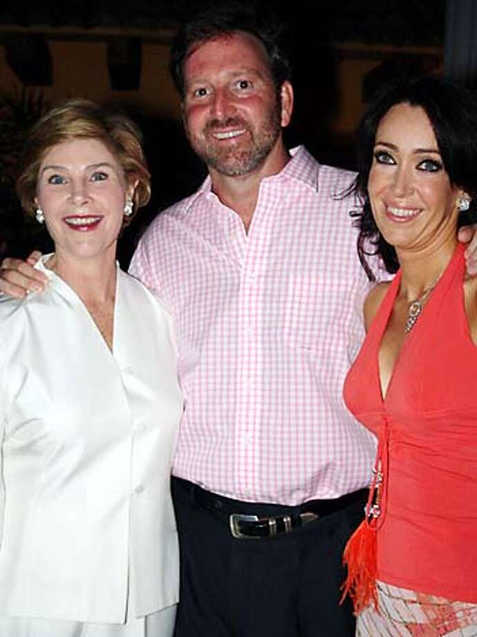 In this photo released by the U.S. Embassy in Mexico, U.S. Ambassador to Mexico Tony Garza, center, smiles with U.S. first lady Laura Bush, left, and his wife Maria Asuncion Aramburuzabala at a party in Valle de Bravo, Mexico, on Friday, April 22, 2005. Four hundred guests gathered in this small traditional lake-side town west of Mexico City for the wedding of Aramburuzabala and Garza on April 23. (AP Photo/U.S. Embassy in Mexico) **EFE OUT** FRIDAY APRIL 22, 2005 PHOTO. PHOTO PROVIDED BY THE U.S. EMBASSY IN MEXICO ON SUNDAY, APRIL 24, 2005 Photo: US EMBASSY IN MEXICO