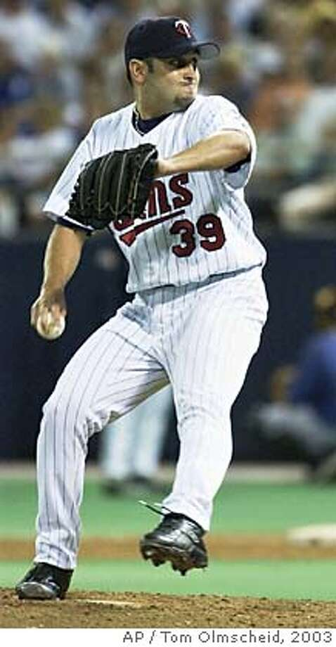 Minnesota Twins relief pitcher Juan Rincon delivers a pitch during a game against the Kansas City Royals Wednesday, July 23, 2003 in Minneapolis. Rincon was suspended for 10 days Monday, May 2, 2005 under Major League Baseball's new policy on performance-enhancing drugs. Ricon is the fifth player to be disciplined under the new policy.(AP Photo/Tom Olmscheid) Photo: TOM OLMSCHEID