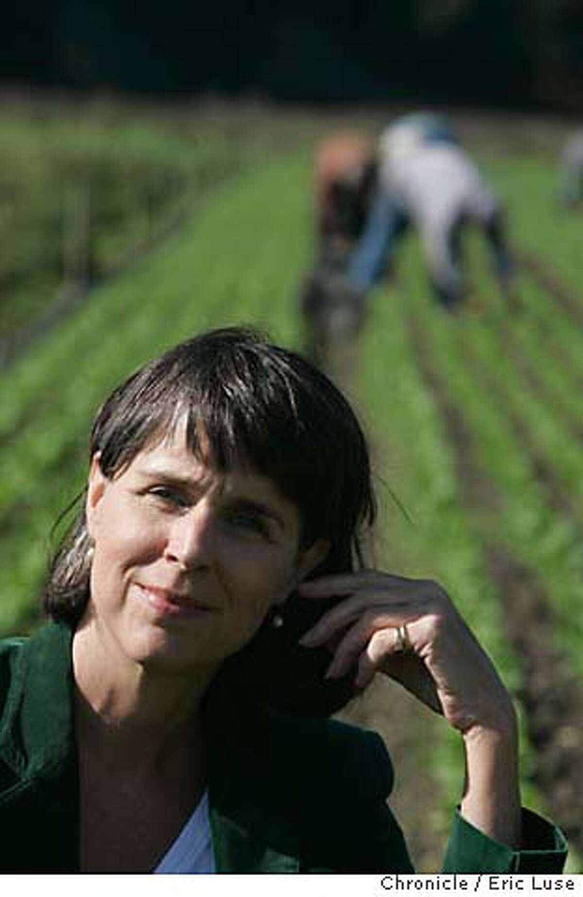 slowfood_056_el.jpg Deborah Koons Garcia Star Route Farms in Bolinas also holding a baby lettuce plant in this organic field. The name of her film is