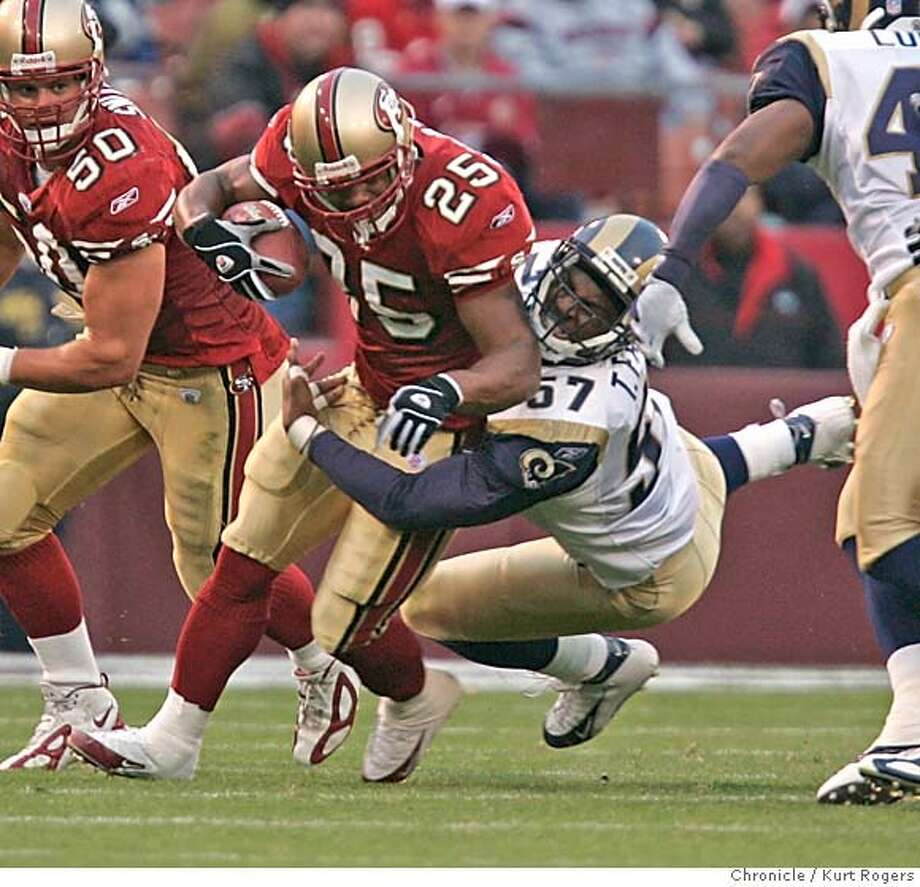 Jamal Robertson is stoped from running the ball back in the second quarterby Trev Faulk.  The San francisco 49ers take on the st louis Rams 10/3/04 in San Francisco,CA.  KURT ROGERS/THE CHRONICLE Photo: KURT ROGERS