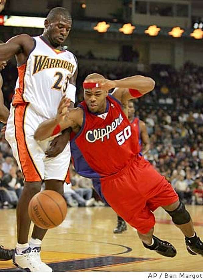 Los Angeles Clippers' Cory Maggette (50) loses control of the ball in front of Golden State Warriors' Jason Richardson (23) during the first half Saturday, Nov. 6, 2004, in Oakland, Calif. (AP Photo/Ben Margot) Sports#Sports#Chronicle#11/8/2004#ALL#5star##0422454840 Photo: BEN MARGOT